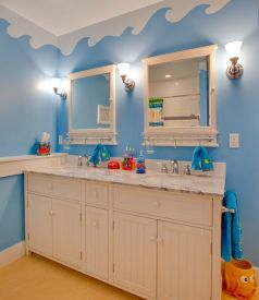 Underwater-world-theme-on-the-walls-with-unique-cabinets-turns-this-bathroom-into-a-world-of-fun